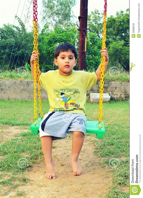 kids swing india kid playing with swing editorial stock image image 33608129