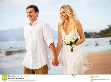 Vacations For Married Couples Just Married Walking On The At Sunset Royalty