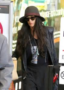 Demi moore sports all black ensemble as she jets into lax daily mail