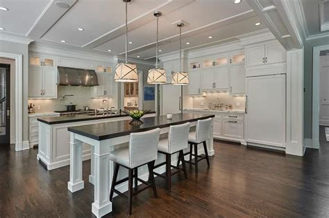 kitchens with 2 islands side by side white kitchen islands with honed black marble