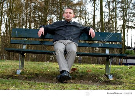person sitting on a bench sitting on a bench image