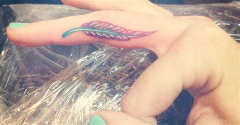 tattoo feather on finger colored finger tattoo feathers appear when angels are