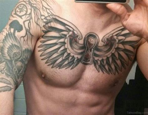 cross with wings tattoo on chest 50 glorious chest tattoos for