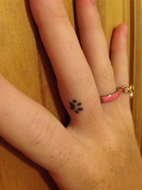 small paw print tattoos small finger paw print tats