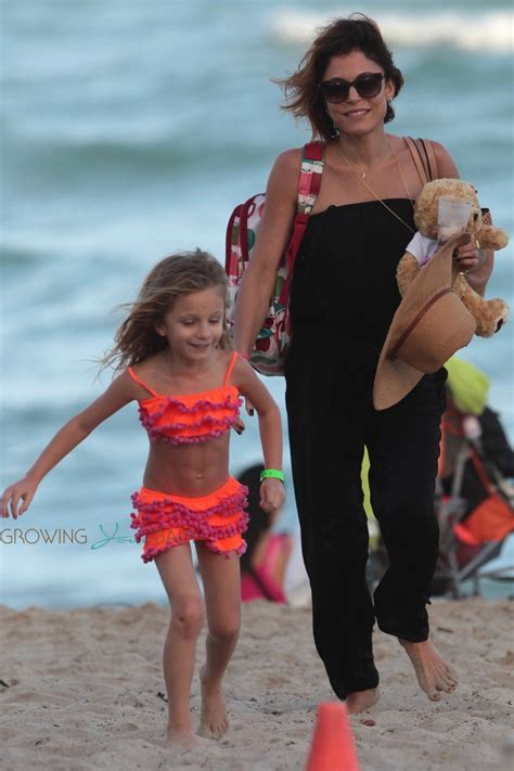 bethenny frankel and her daughter bryn collect shells on