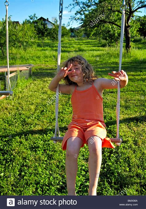 swing in german quot 4 year old quot german girl in orange dress playing on an