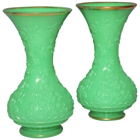 pair of antique baluster shaped opaline glass vases