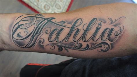 forearm name tattoo designs by lou shaw four aces aldinga