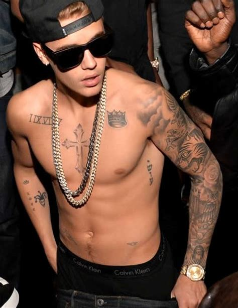 justin bieber s 23rd tattoo a ferocious eagle on his left