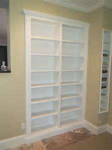 custom two column built in bookshelf in white