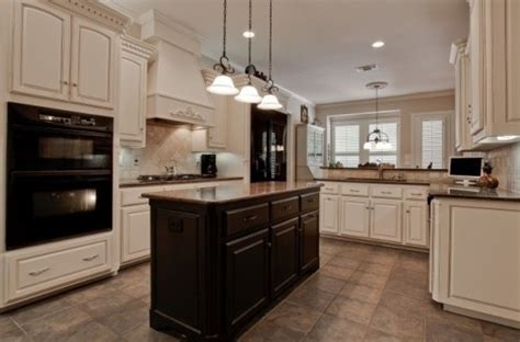 ivory cabinets, black appliances, dark island   For the