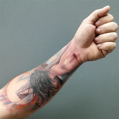 jesus tattoo using hand hand of god creative jesus crucifixion tattoo goes viral