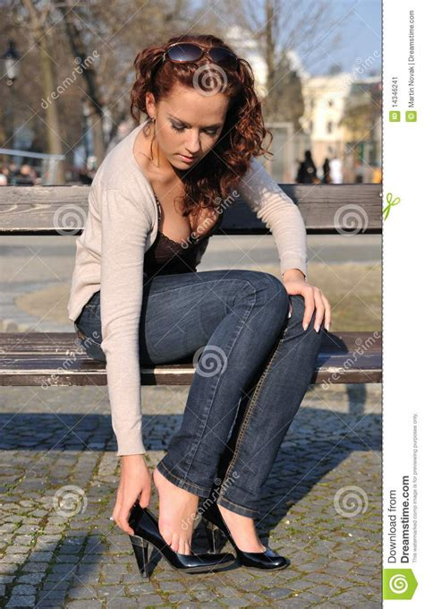 bench for putting on shoes young woman putting on shoes stock image image 14346241