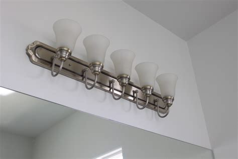 olive and spray painting bathroom light fixture