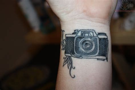 camera wrist tattoo on wrist