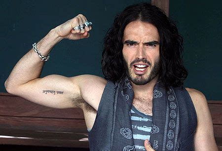 russell brand tattoo removal brand sanskrit bicep a drop of ink