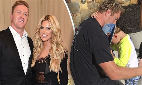 kim zolciak shares a sweet snap snuggling with husband kim zolciak shares sweet snap of their twins hugging kroy