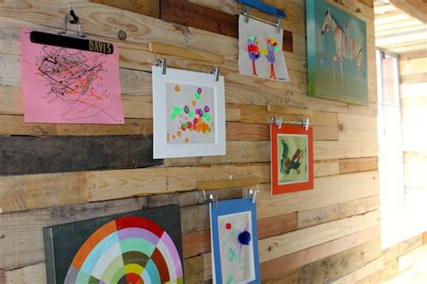 how to display art prints how to creatively display your kids art using hangers