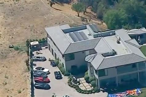 chris brown emerges from tarzana mansion after eleven hour
