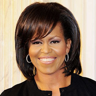 google michelle obama new hairstyle why is michelle obama being chastised for adorning beyonce