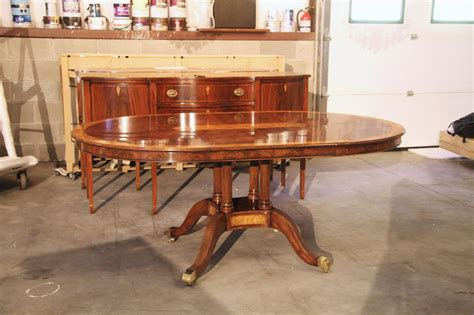 48 inch to oval walnut and yew banded dining table