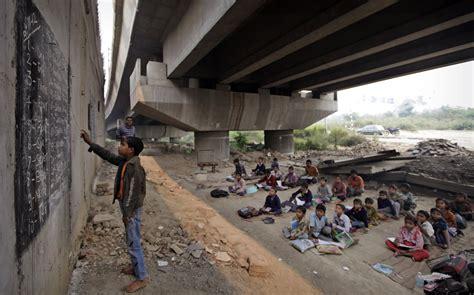 children in indian school school bridge in new delhi offers free education to Poor