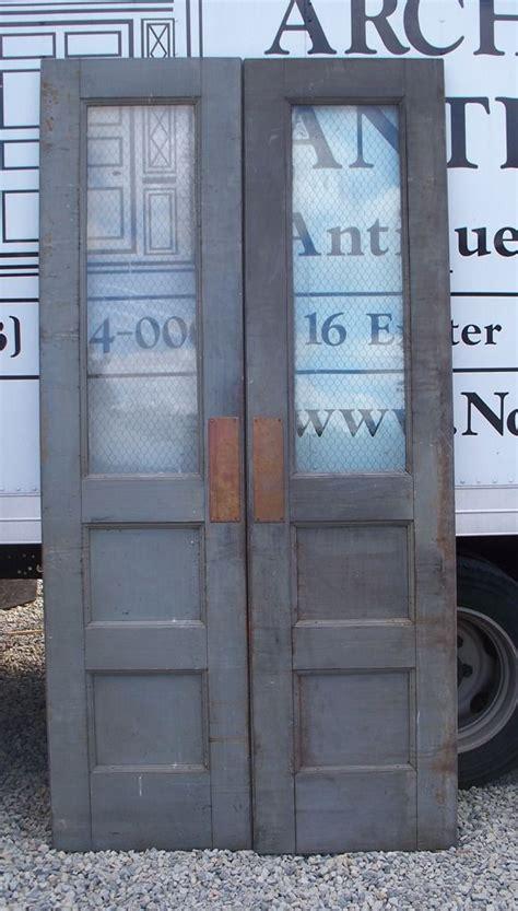 steel clad double doors wchicken wire glass