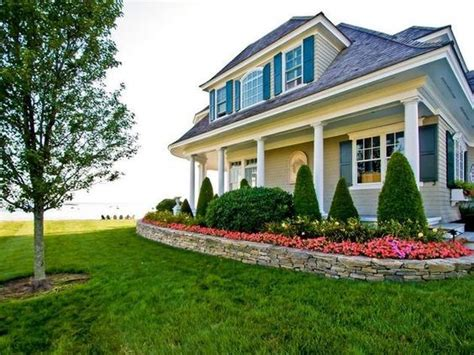 landscaping and wrap around porch high school pinterest landscaping stone work and porches