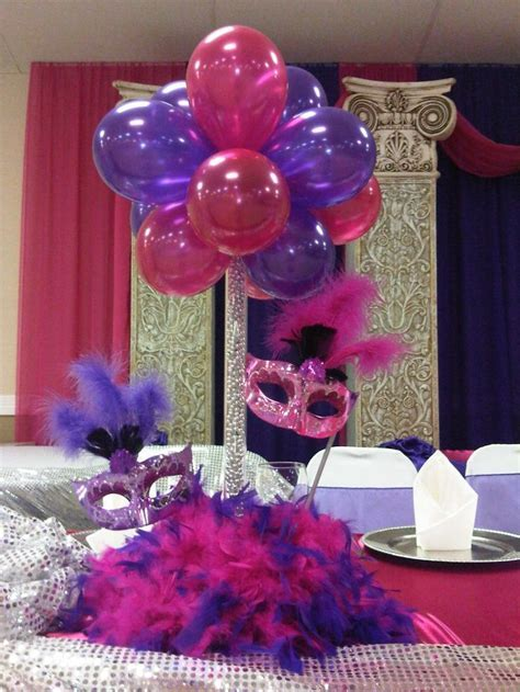 quinceaneras centerpieces   Balloon centerpiece with masks