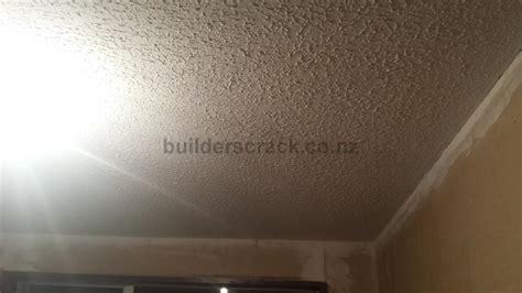 Removing Stipple Ceiling by Trades Asbestos Builderscrack