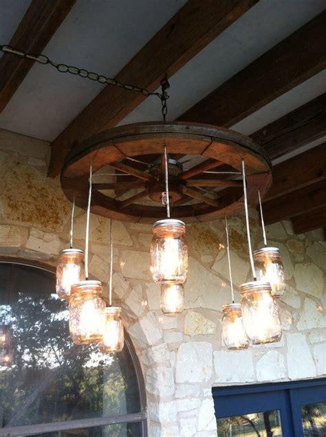 wagon wheel light with mason jars wagon wheel chandelier image of luxury wagon wheel