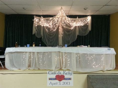 diy mosquito curtains diy wedding head table above mosquito netting holding