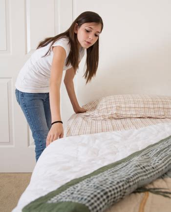 making bed get your kids to clean their rooms