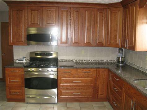 medium oak kitchen cabinets kitchen stainless appliances medium oak cabinets five