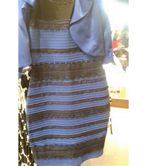 the dress is blue and black says the girl who saw it in white and gold or blue and black the dress that s