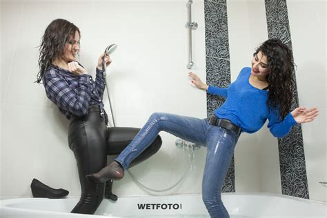 wear jeans in bathtub two girlfriends in soaking wet clothes have fun in jacuzzi