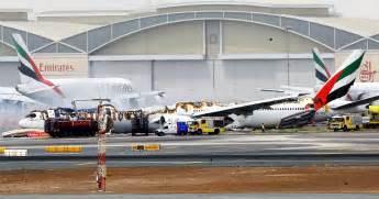 emirates plane crash lands with 300 aboard 1 firefighter
