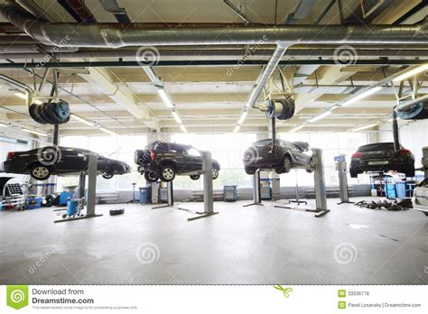 4 Car Garage Plans four black cars raised on lifts in garage editorial stock