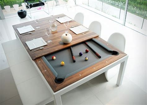 pool table kitchen table combo this dining table hides a pool table underneath