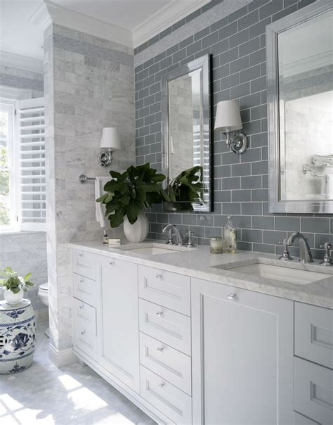 bathroom white grey blue grey subway tile over double sink with marble