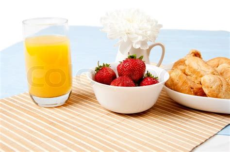 Light Breakfast by Light Breakfast Orange Juice Croissants And Berries On A