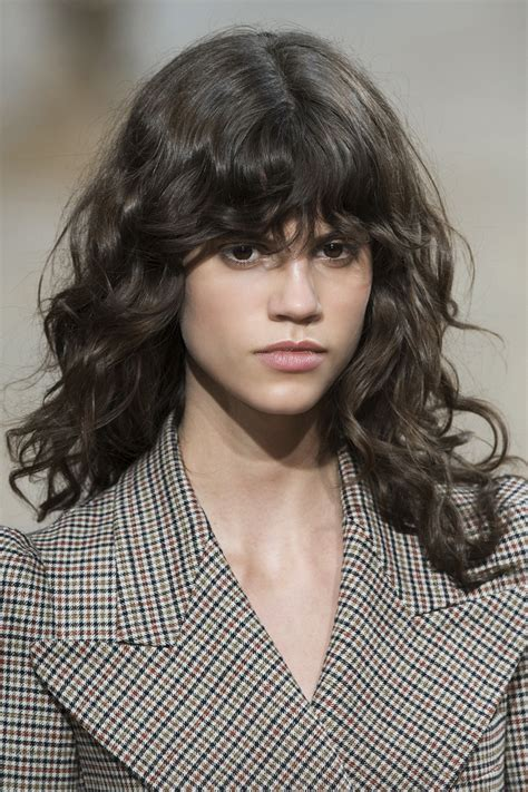 permed hair with bangs yes curly bangs are back here s how to pull them off