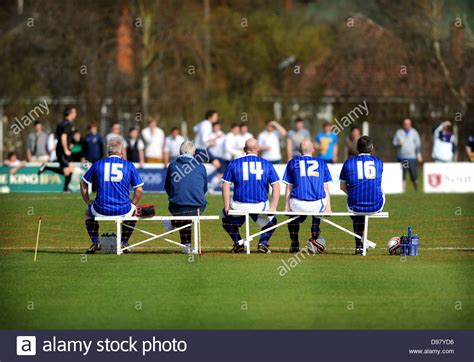 football bench men waiting on the bench at a football game stock photo
