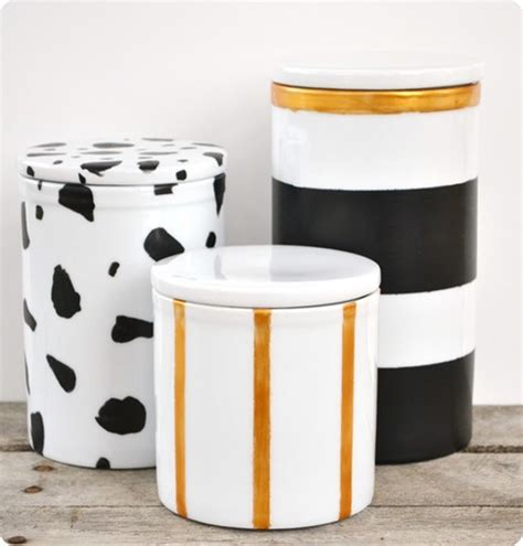 black and gold painted storage canisters