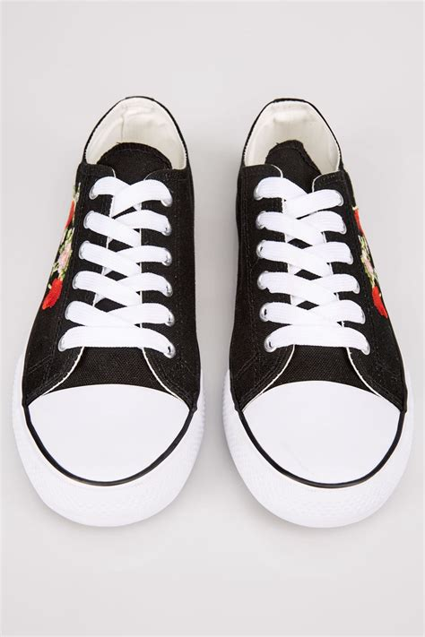 div placement black embroidered lace up canvas trainers in true eee fit