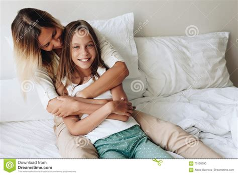 in bed with mom mom with tween daughter stock photo image 70120590