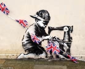 banksy diamond jubilee graffiti  sweatshop boy appears
