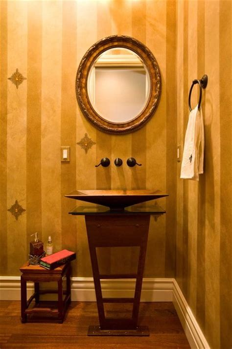powder room with gold paint with jewels and metal pedestal
