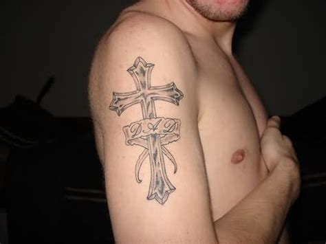 cross with a banner tattoo designs 49 cross shoulder tattoos