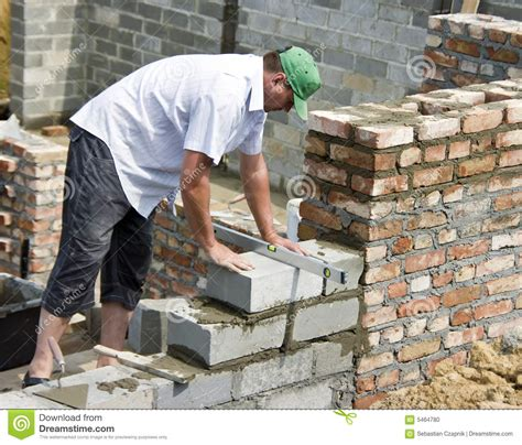 New Home Building Plans by Bricklayer At Work Stock Photo Image 5464780